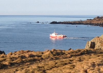 Boat leaves the Isle of Whithorn